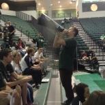 The BU Zoo President Andrew Loso addressing the section at the Basketball Showcase