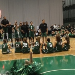 The men's basketball team cheers after a flip