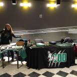 BU Zoo Secretary Kim Lato poses in front of the BU Zoo table at the viewing party