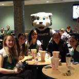 Baxter poses with members of the Dance Team at the viewing party