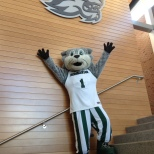 Baxter posed in front of the new Bearcats logo in the Fleishman Center