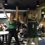 Dance Team member Shannon Moran and Baxter the Bearcat at the viewing party