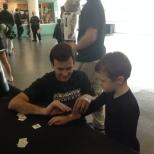 VP of Marketing Nate Holahan gives a young Bearcats fan a BU Zoo temporary tattoo