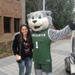 Baxter poses with a student on Green Day Friday