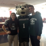 Baxter poses with students on Green Day Friday