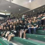 The Cheer team posed in front of the packed students section on Tuesday night