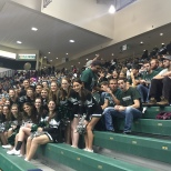 The Cheer team posed in front of a packed students section
