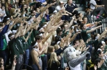 Students showing 'spirit fingers' to cheer on a BU free throw shooter