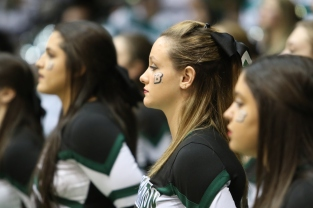 Cheerleader Cabrina McGinn cheers on the Bearcats