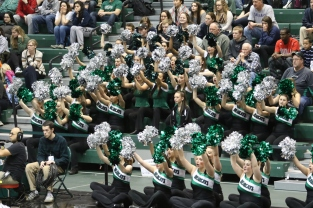 Spirit squads cheer a free throw