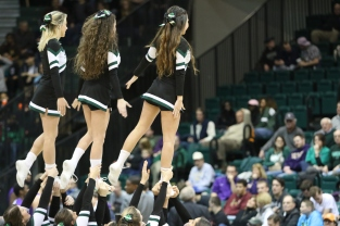 BU Cheer performs on the court